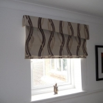 Roman blind & upholstered pemet using Clarke & Clarke fabric, Northumberland