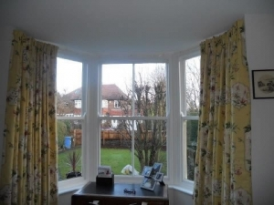 Interlined curtains with deep pleat heading in bay window using customers own fabric, Ponteland